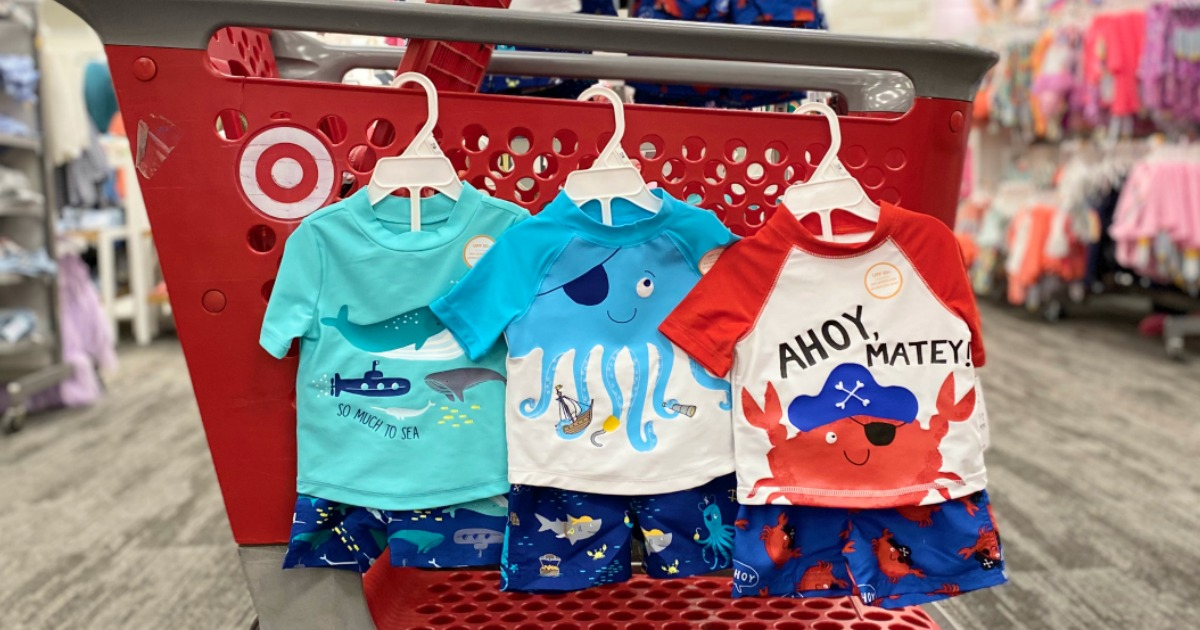 boys swimsuits hanging on Target cart