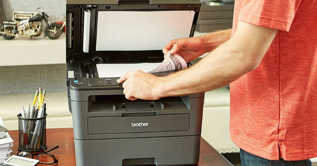 person copying something on a printer