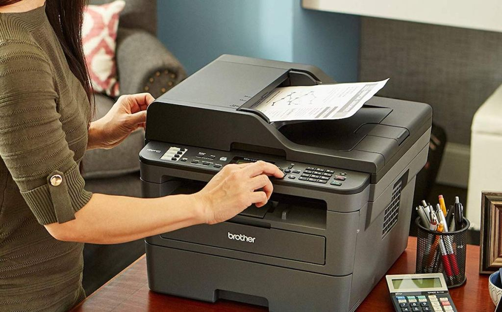 person copying on a printer