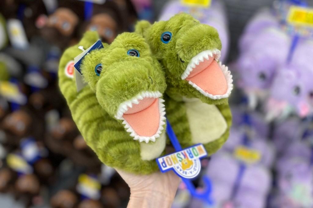 hand holding Build-A-Bear Dinosaur Slippers