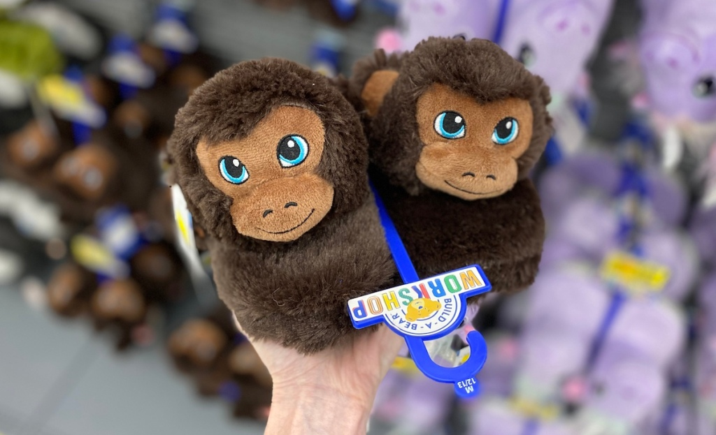 hand holding a pair of Build-A-Bear Monkey Slippers