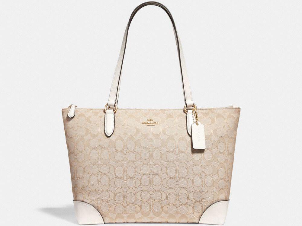 white and tan COACH purse