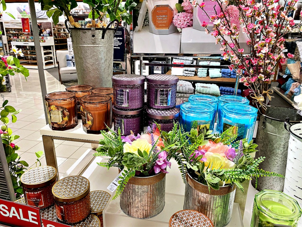 Candles and spring flowers on shelf at Kohl's