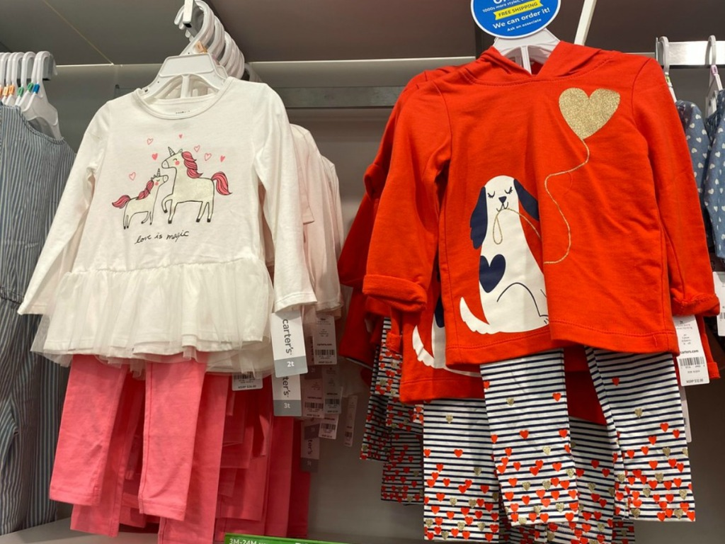 Girls 2-piece outfits on display in-store on hangers