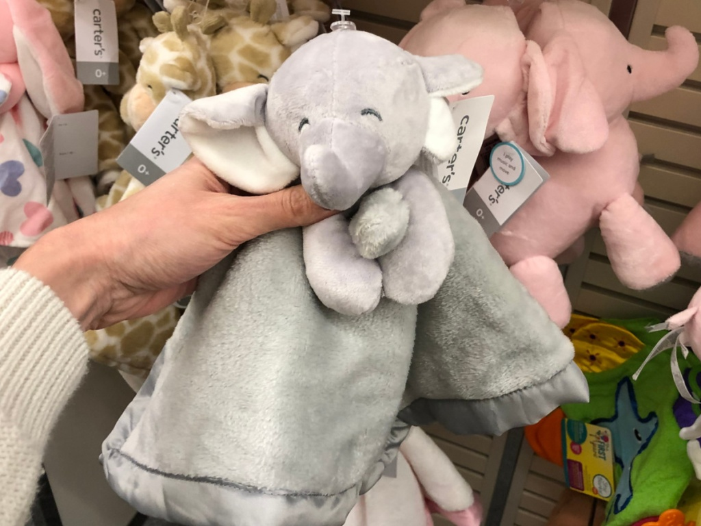 Woman's Hand holding Carter's Elephant Security Blanket