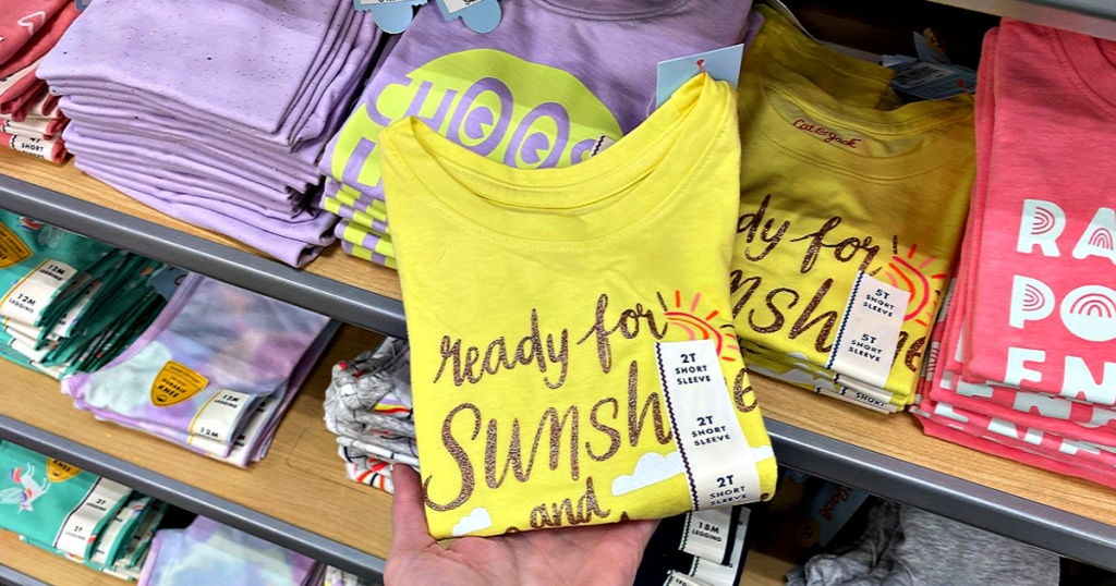 Cat & Jack Toddler Girls' Short Sleeve Sunshine Graphic T-Shirt in hand at target