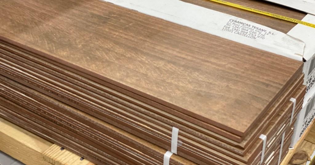 stack of Ceramicas Tesany Acadia Brown Matte Wood Look Ceramic Floor in store