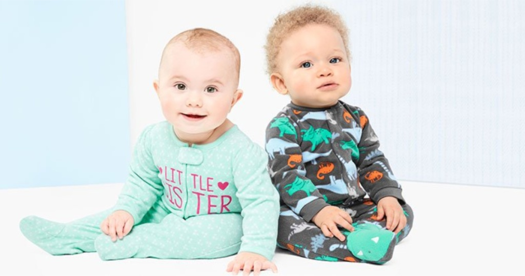 two babies wearing child of mine by carter's footed pajamas