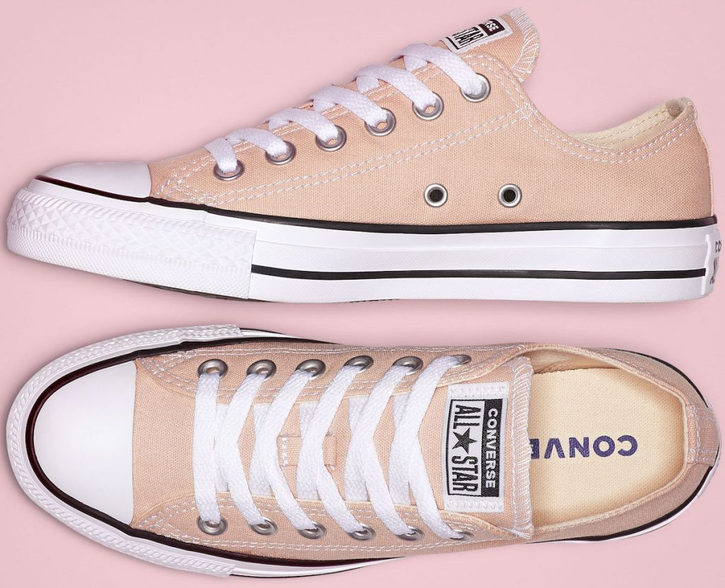 pair of Chuck Taylor Women's All Star Seasonal Color Low Tops in Particle Beige on pink background