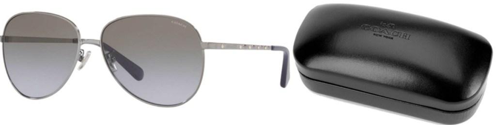 Aviator style women's sunglasses with silver rims near Coach brand case