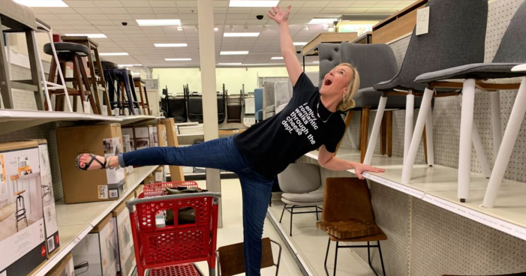 woman standing on brown chair in isle at target