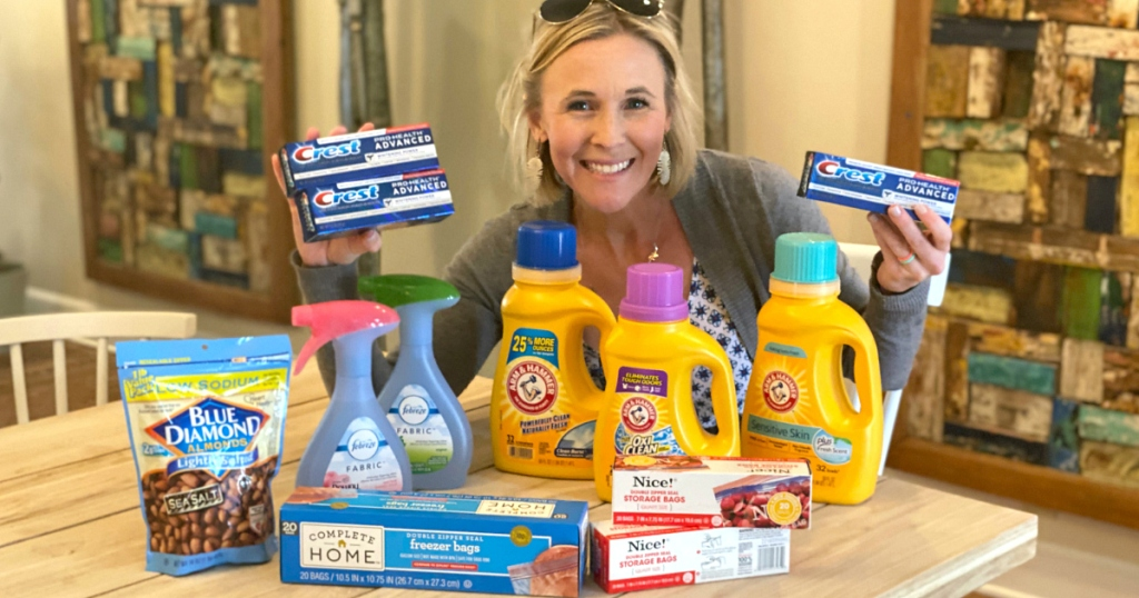 woman holding Crest and other grocery products