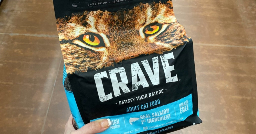 hand holding bag of Crave Cat Food