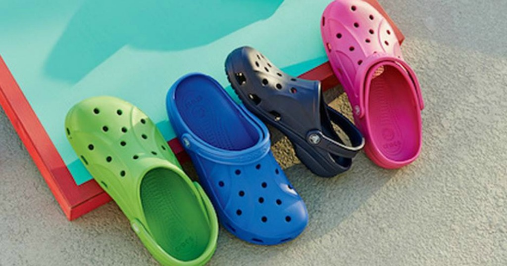Crocs shoes in green, blue, black, and pink