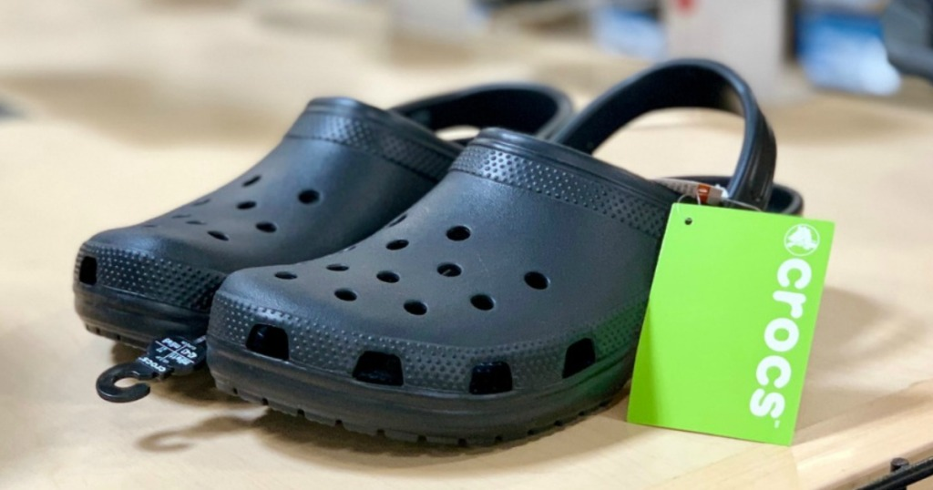 clogs with a green tag