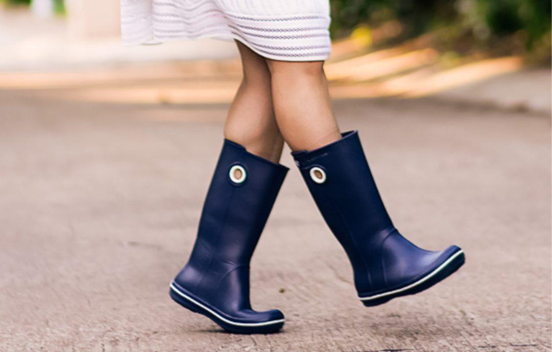 Woman wearing blue rain boots outside