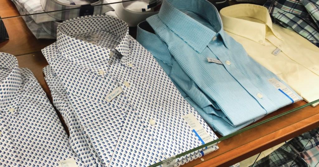 Men's dress shirts on store table