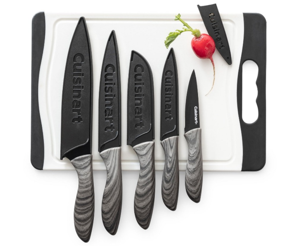 black and great knives set on cutting board