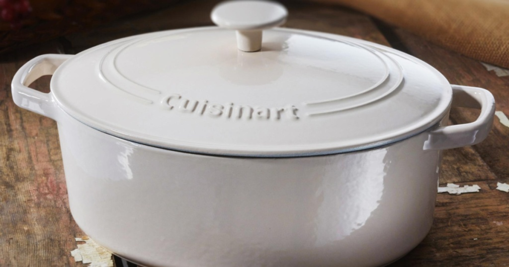 white Cuisinart Round Cast Iron Casserole on wooden table