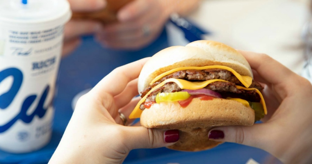Woman holding Culver's hamburger