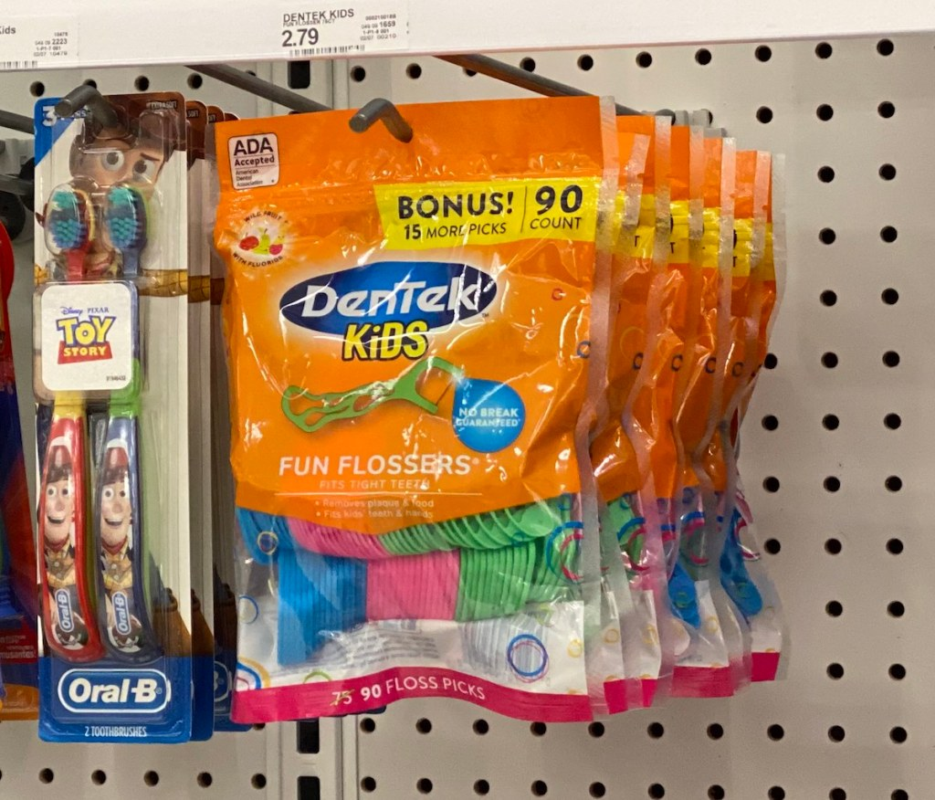 rack with toothbrushes and flossers at Target