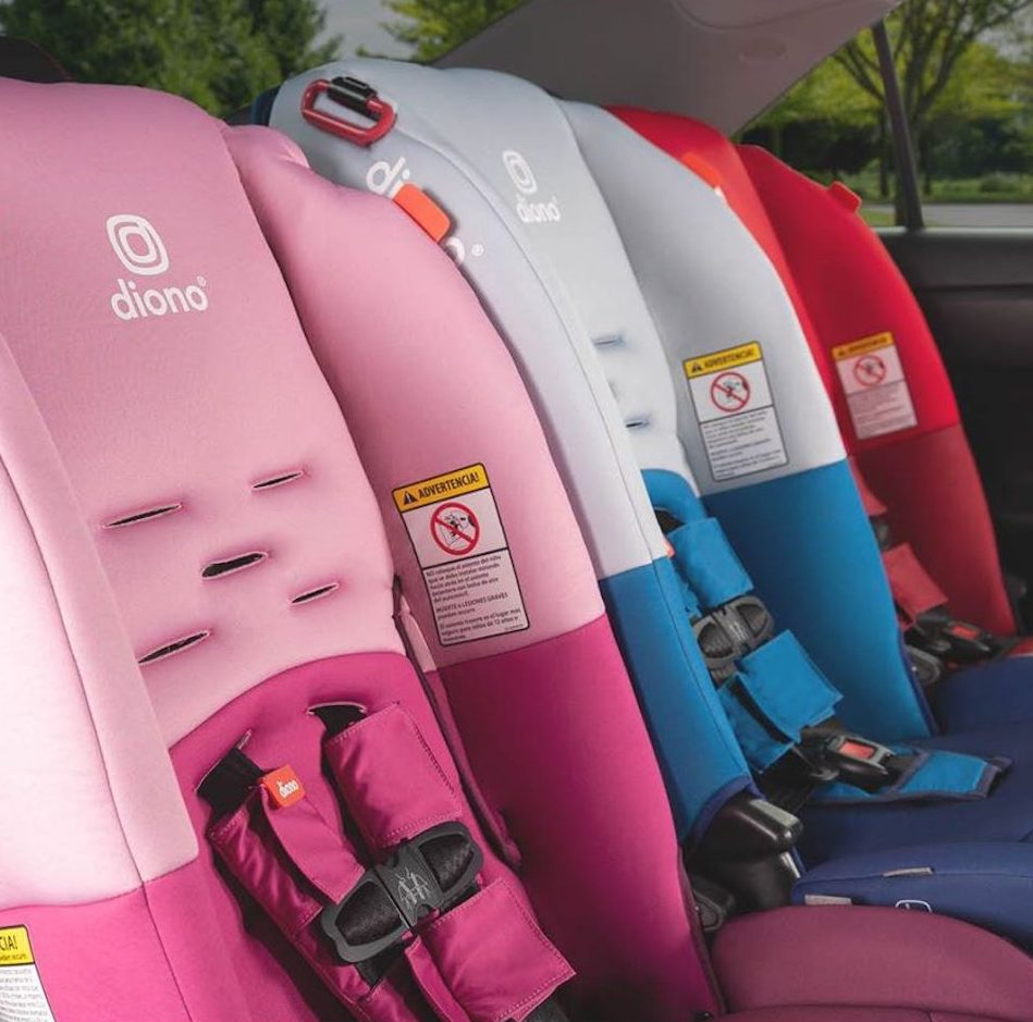 pink blue and red car seat in the back of a car