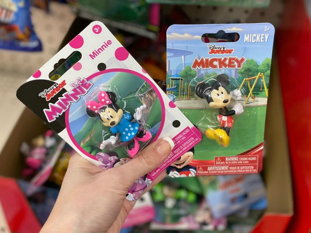 hand holding packages containing little Micky characters
