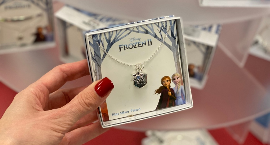 hand holding a jewelry box with a Frozen 2 Necklace