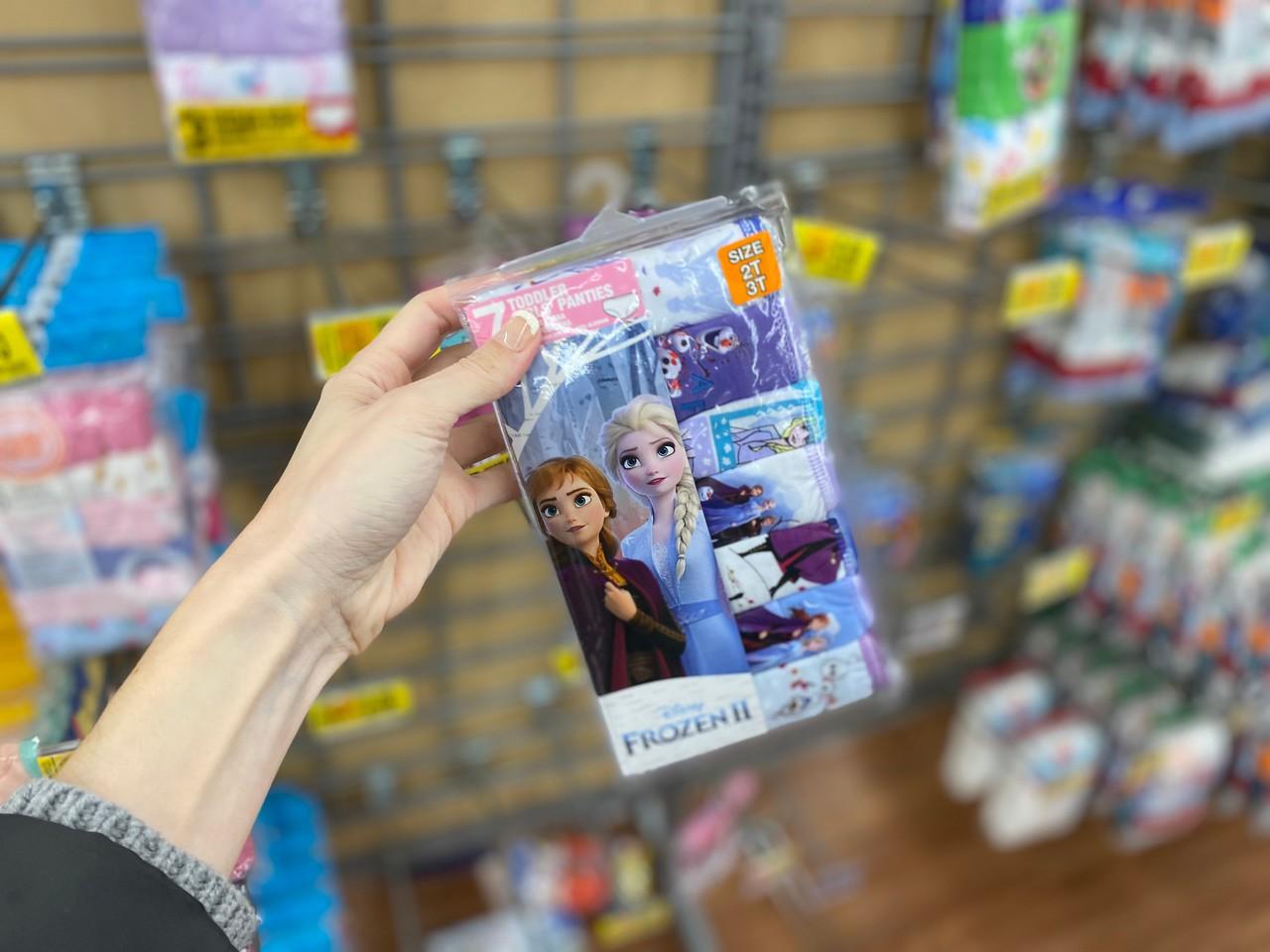 Woman's hand holding Disney Frozen Toddler Panties