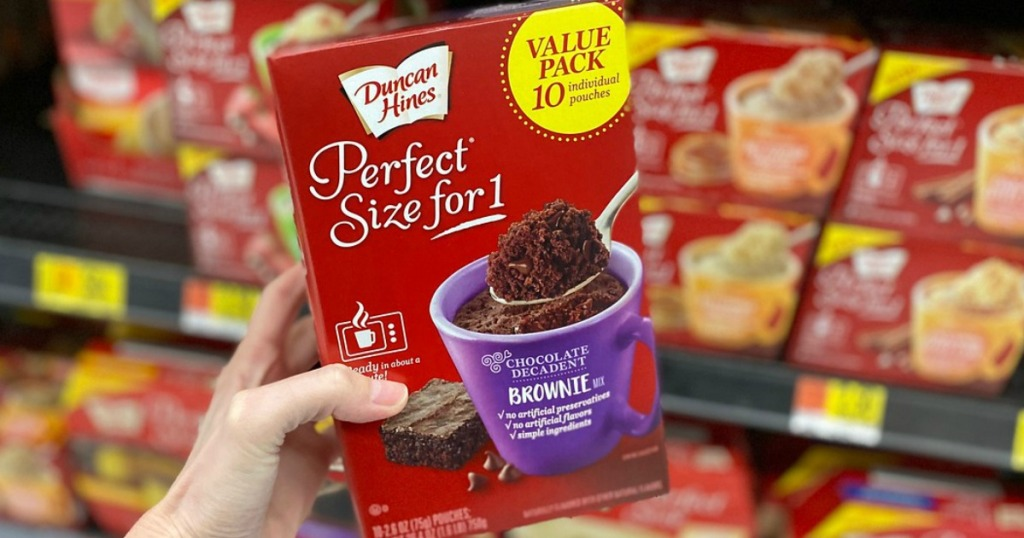 woman holding Duncan Hines Perfect Size for 1 Chocolate Decadent Brownie Mix Multipack