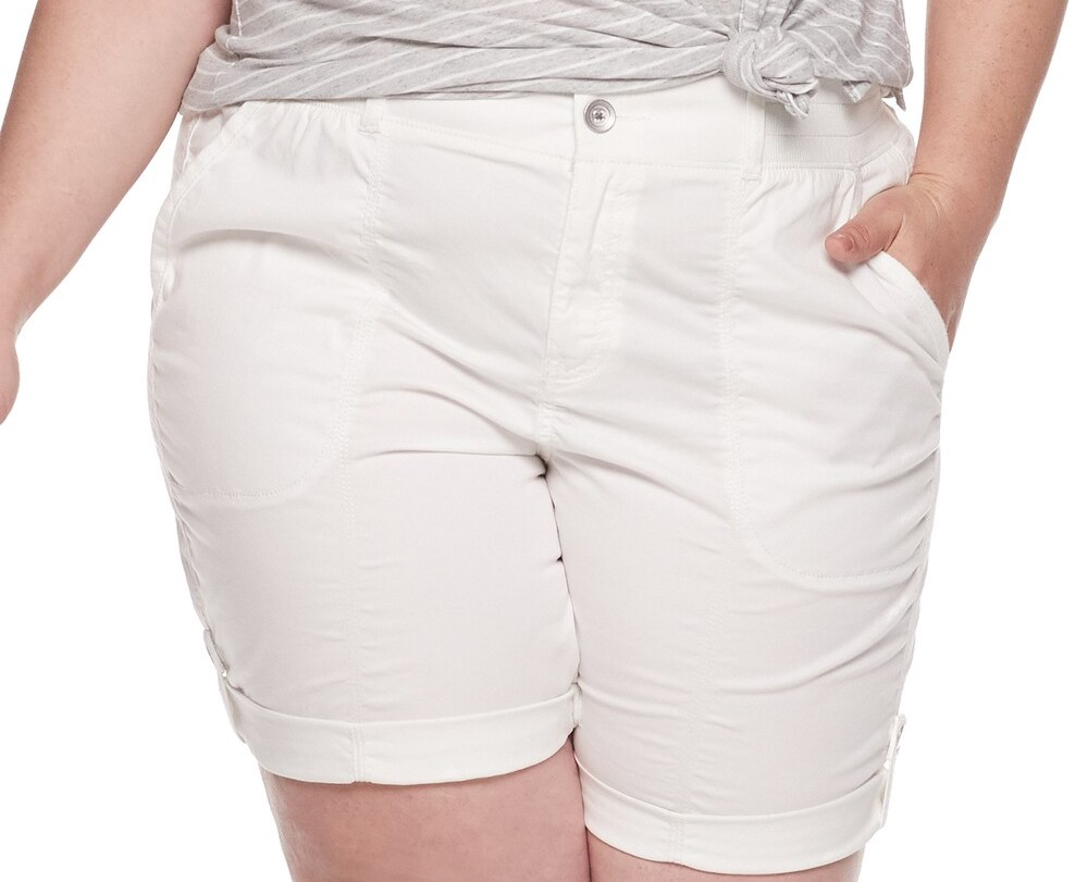 person wearing a pair of white shorts