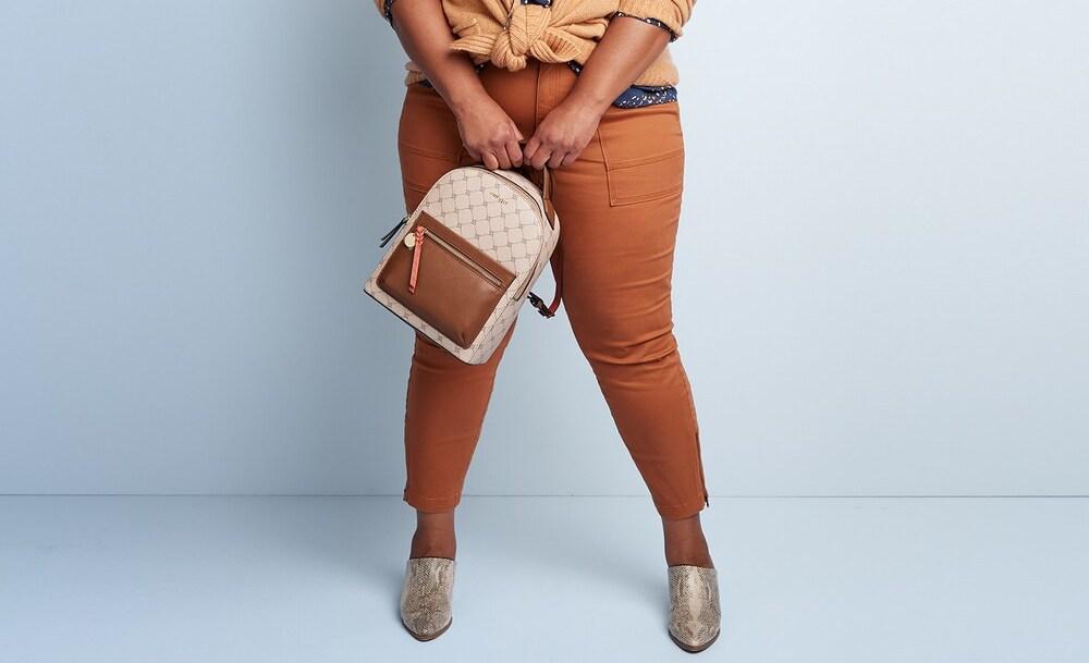 womans legs wearing brown jeans
