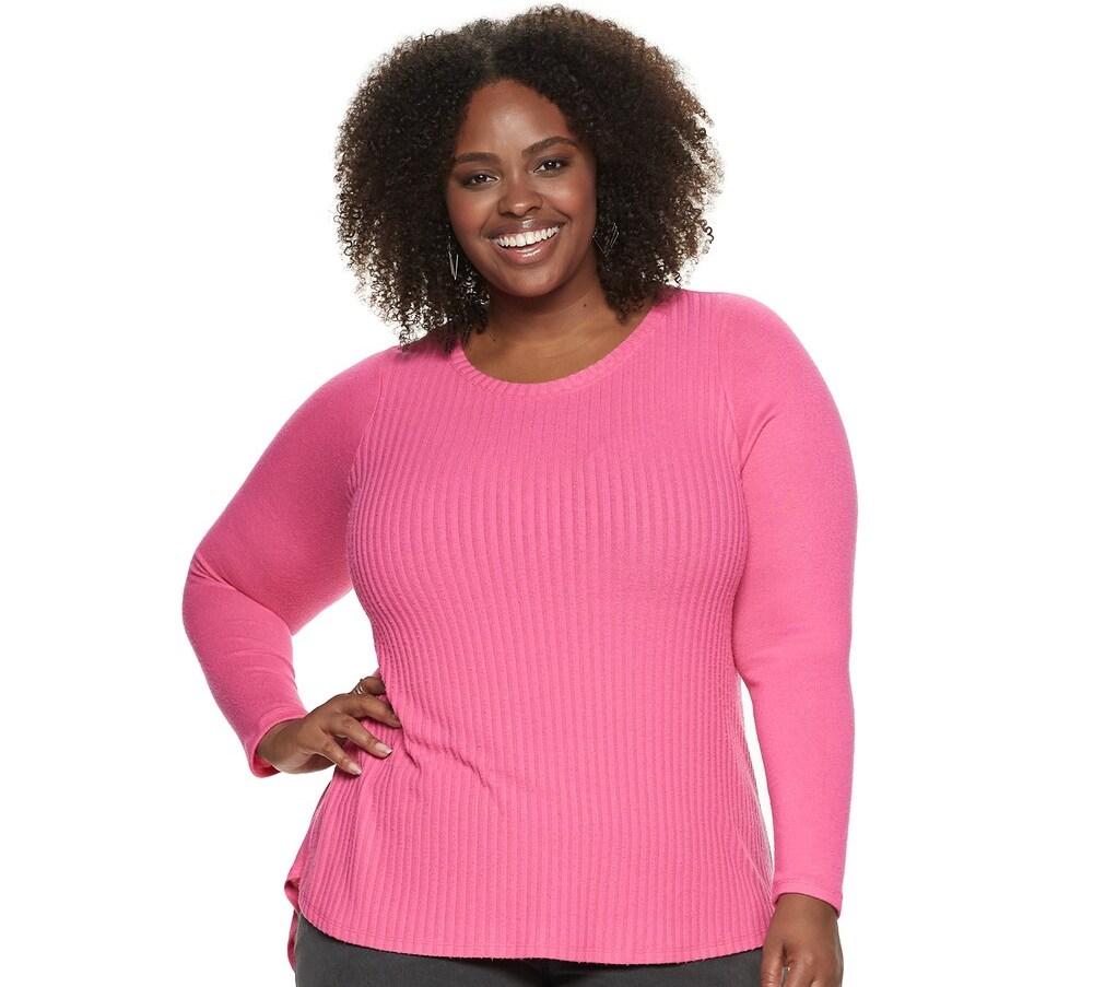 woman wearing a pink long sleeve shirt