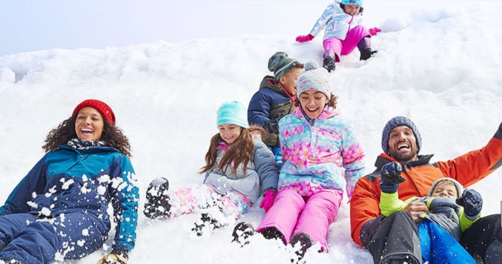 Family wearing Eddie Bauer winter gear in the snow