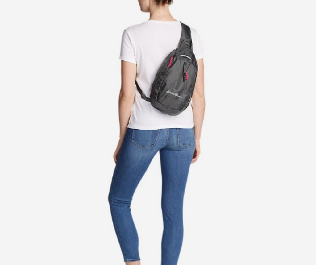 woman wearing Eddie Bauer Stowaway Packable Sling Bag