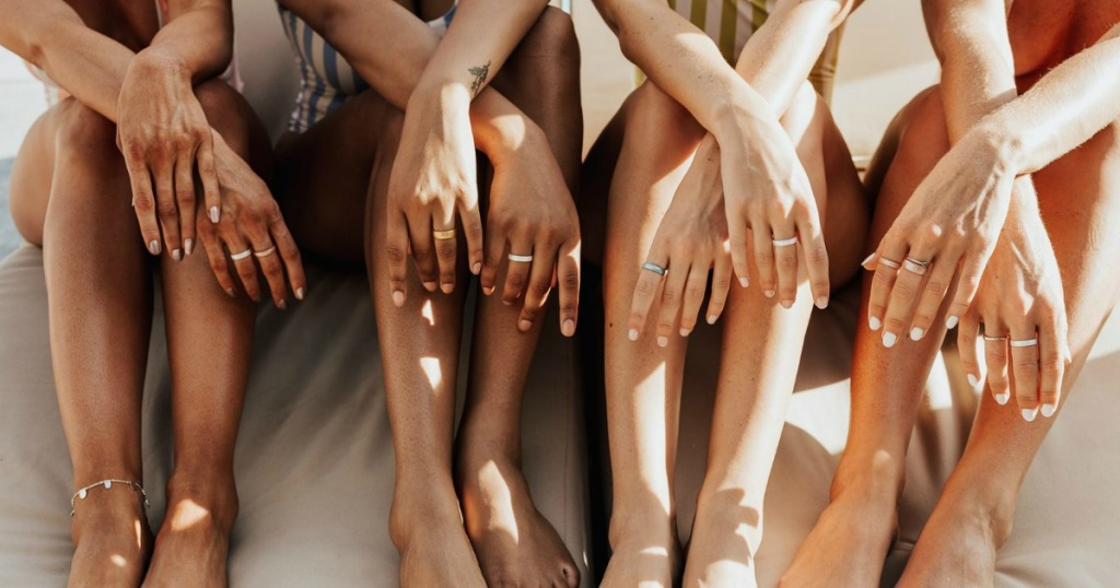 women sitting together and wearing silicone rings