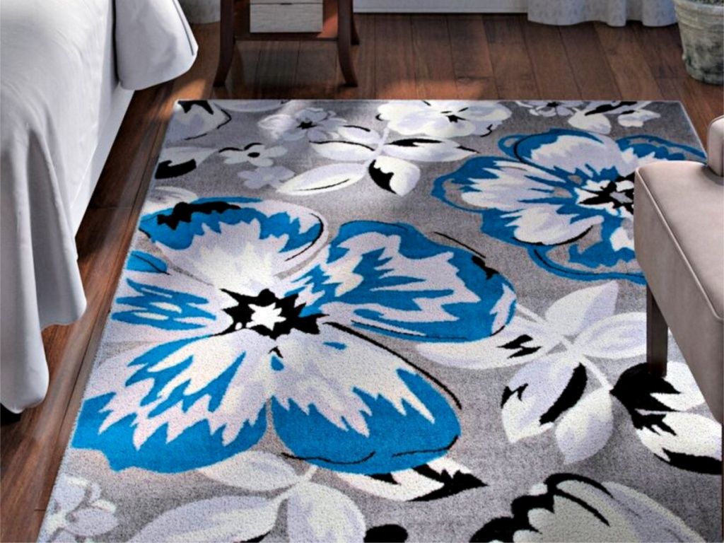 Ericson Blue Area Rug in bedroom with chair and bed