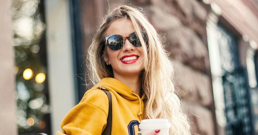 Woman wearing fashion sun glasses outside a building