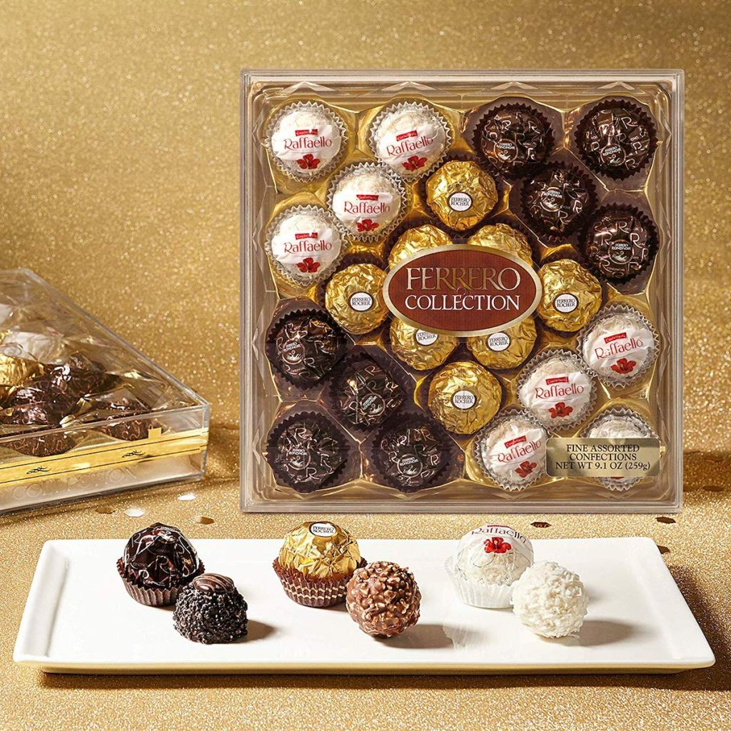 Ferrero Rocher chocolates on a plate with a box of chocolates behind them