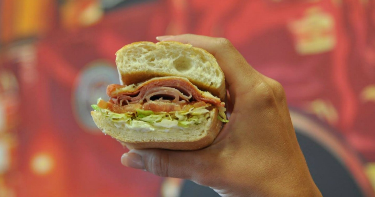 Person holding Firehouse sub