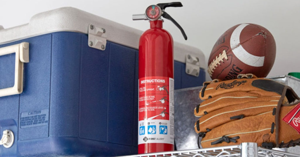 fire extinguisher and cooler and football and glove on shelf