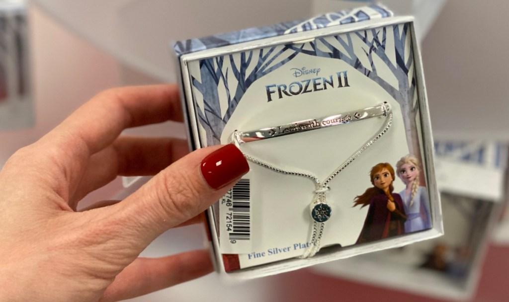 hand holding Frozen 2 Bracelet box