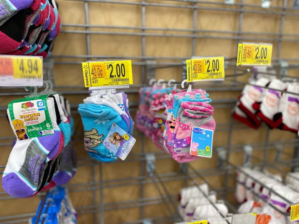 Frozen Socks and Peppa Pig Socks hanging on store pegs