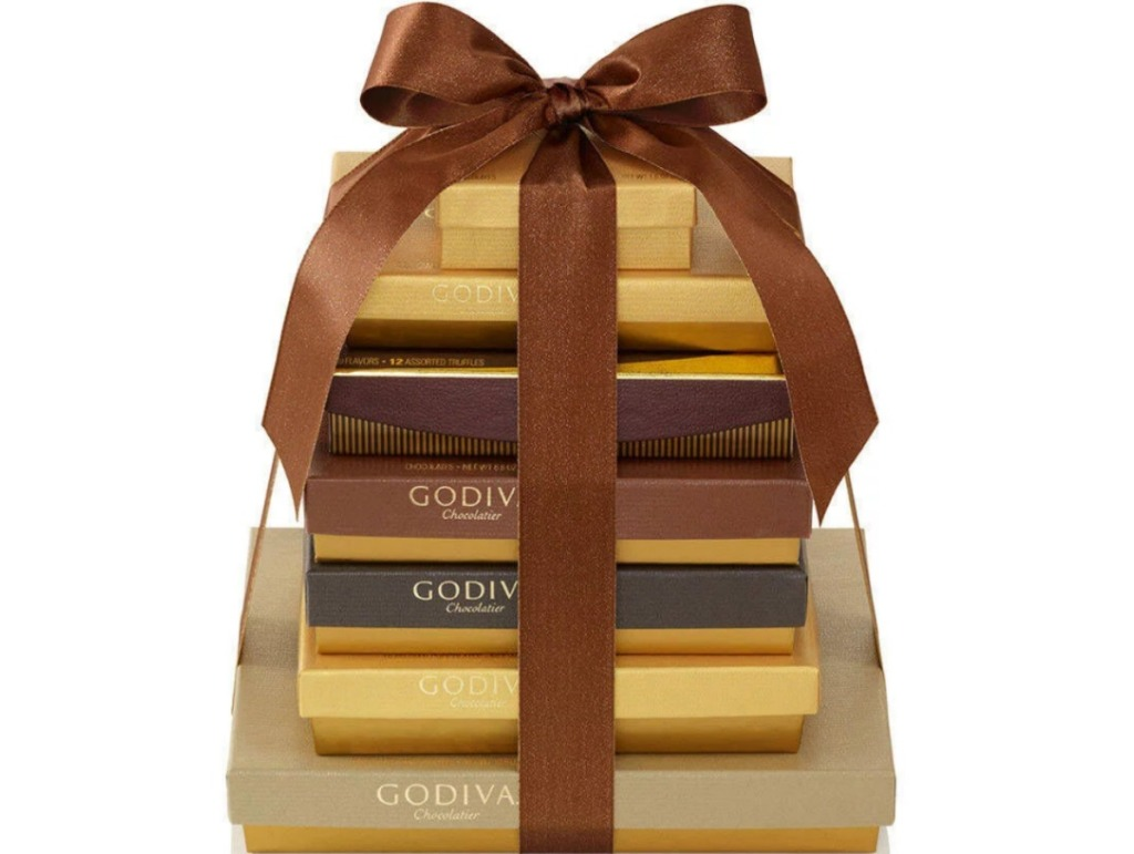 seven gold boxes stacked and tied with a ribbon
