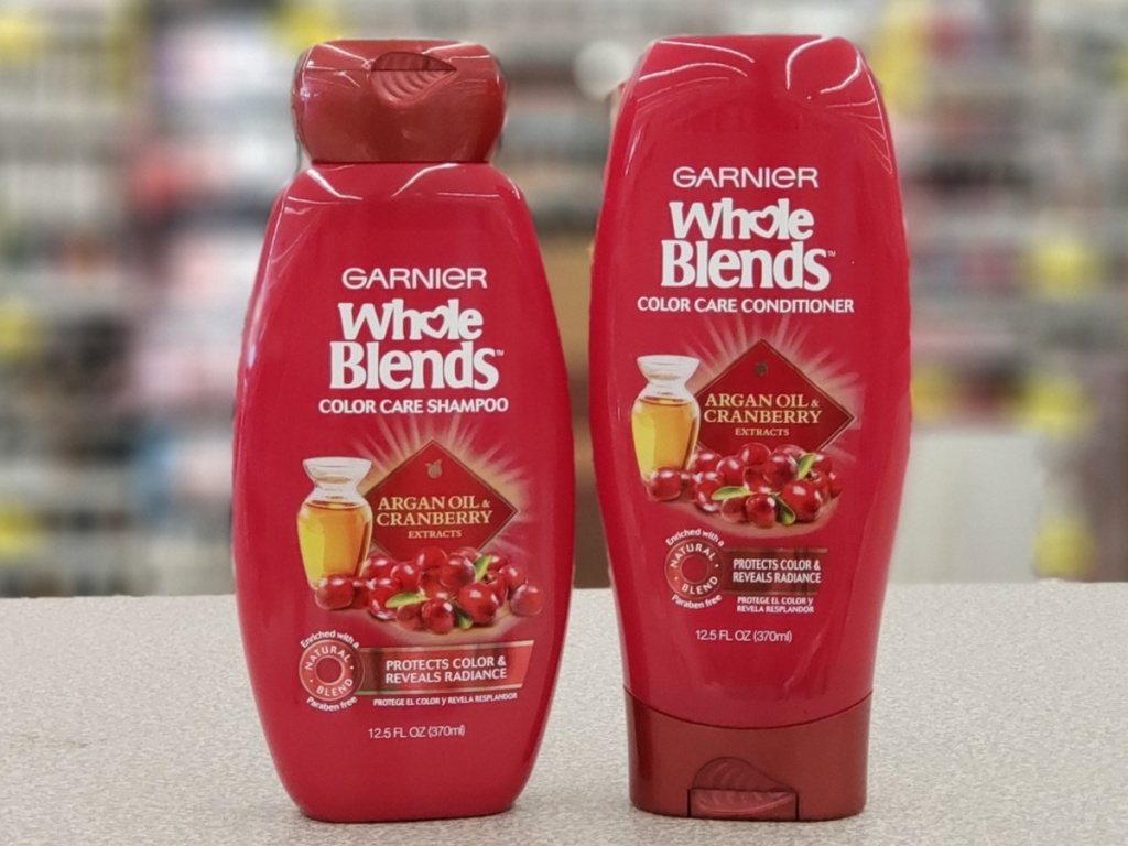 Two bottles of shampoo in store