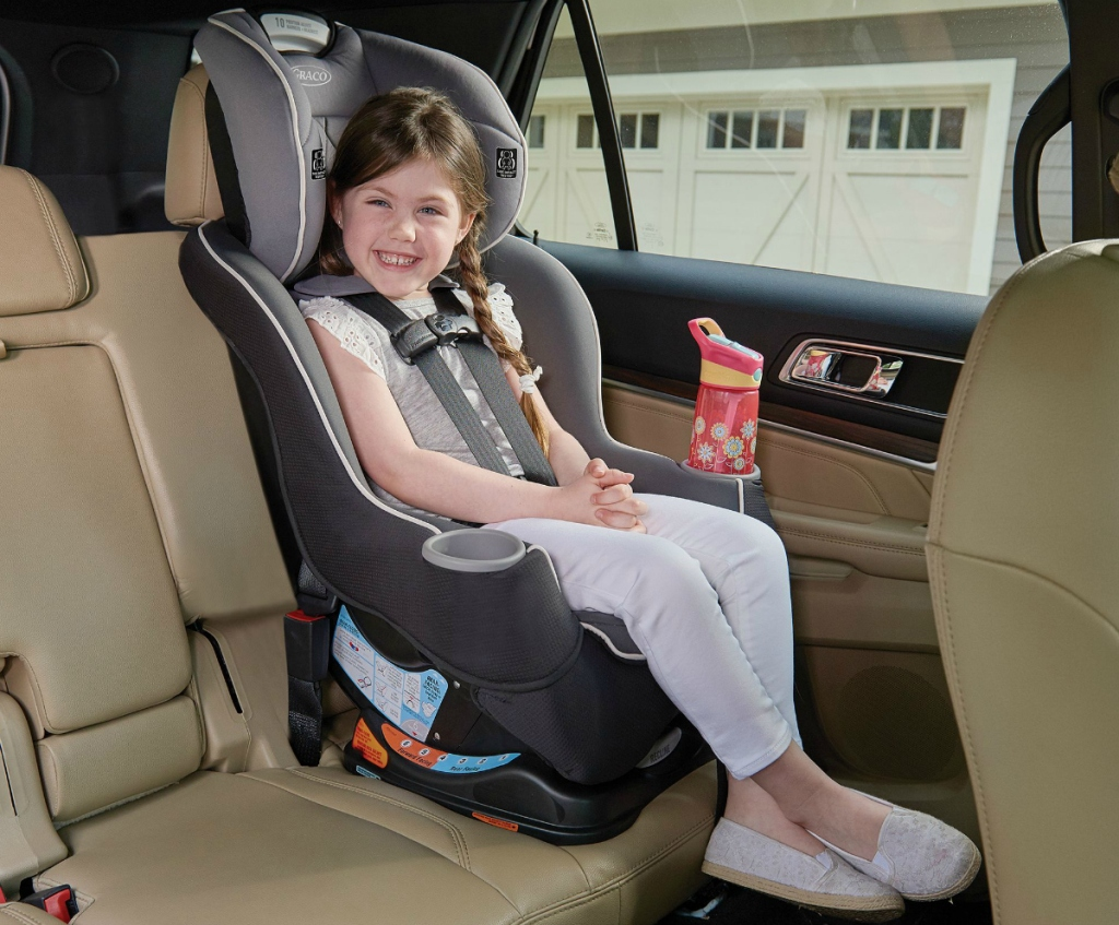 Girl in Graco Sequence 65 Platinum Convertible Car Seat