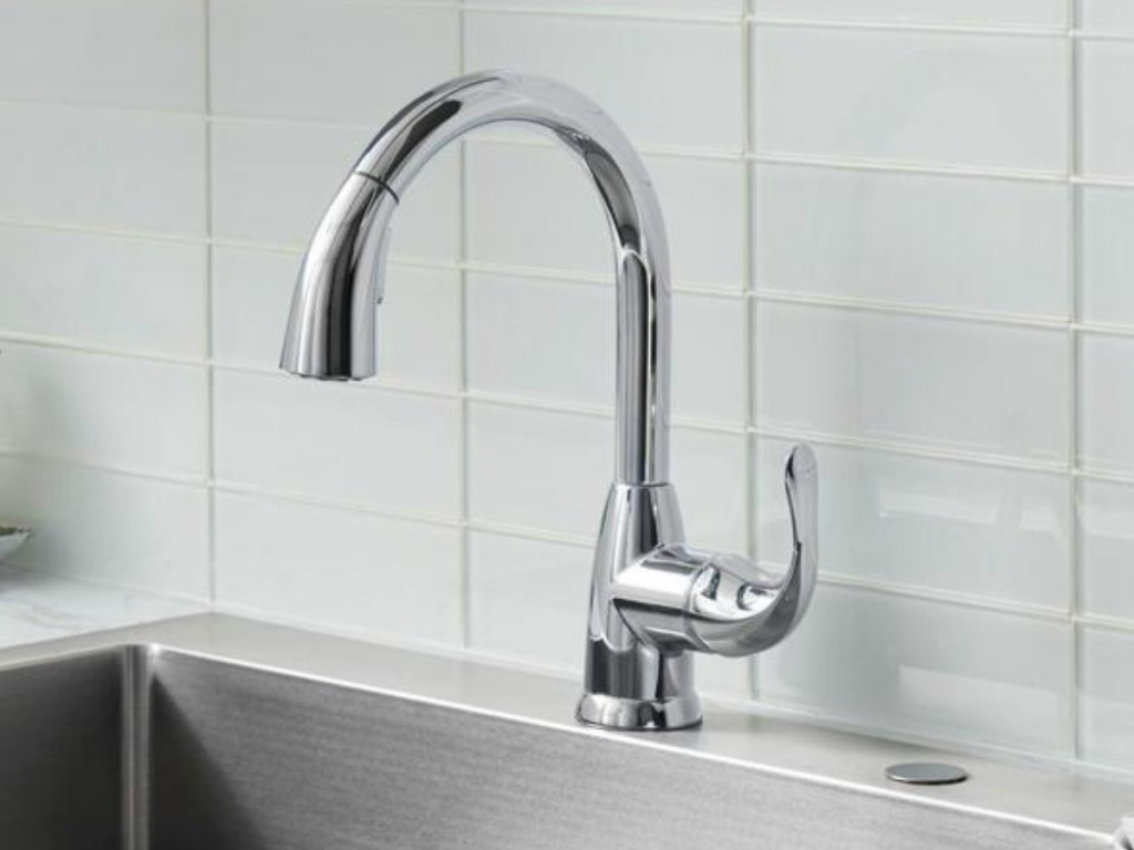 Stainless steel faucet on large porcelain sink