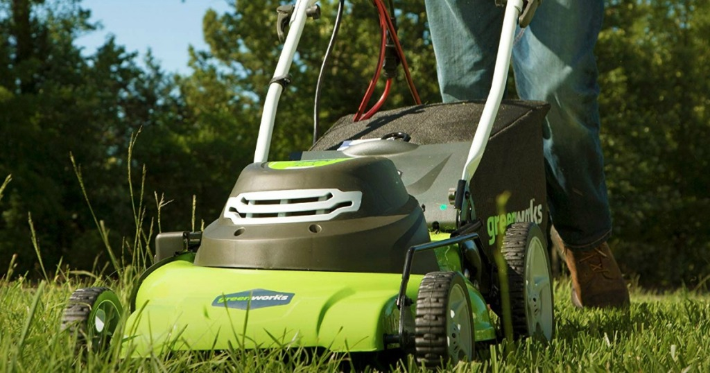 Large green lawnmower mowing the grass