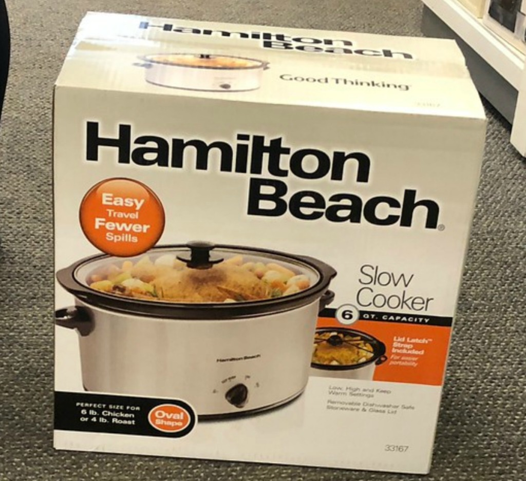 Large slow cooker in package on floor in-store