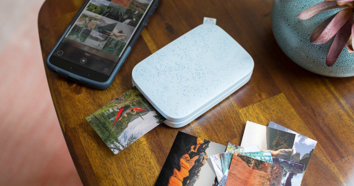 HP Sprocket Printer in Luna Pearl printing a picture on a table